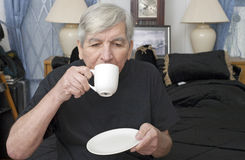 Senior man drinking from cup Stock Photography