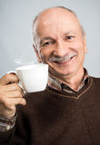 Senior man drinking cup of coffee Royalty Free Stock Photos