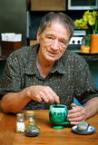Senior man drinking herbal tea Stock Photo