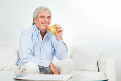 Senior man drinking juice Stock Photo
