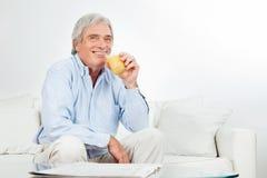 Senior man drinking juice Stock Photo
