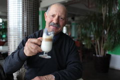 Senior man drinking latte Stock Photography