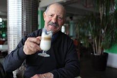 Senior man drinking latte Stock Photography