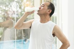 Senior man drinking milk. Stock Images