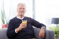 Senior man drinking refreshing drinks Stock Image
