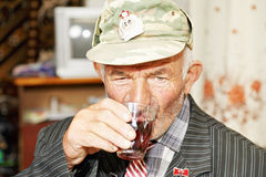Senior man drinking tea Stock Image