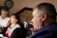 Senior man drinking tea Stock Images