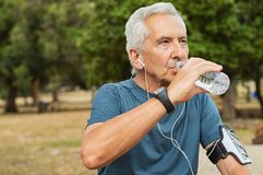 Senior man drinking water royalty free stock photo