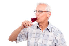 Senior man drinking wine Royalty Free Stock Photos