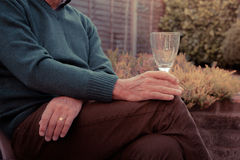 Senior man drinking wine in garden Royalty Free Stock Photos