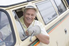 Senior Man In Driver's Seat Of Campervan Looking Through Window Stock Image