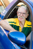 Senior man driving a car Stock Image