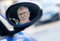 Senior man driving a car Royalty Free Stock Photo
