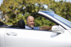 A senior man driving a car Stock Image