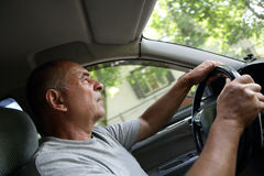 Senior man driving a car Royalty Free Stock Photography