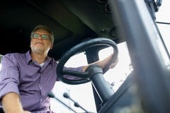 Senior man driving tractor at farm Royalty Free Stock Photography