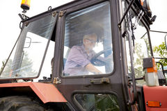 Senior man driving tractor at farm Royalty Free Stock Photo