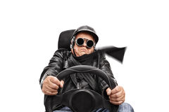 Senior man driving very fast Royalty Free Stock Photography