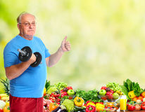 Senior man with dumbbell. Royalty Free Stock Photos