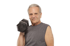 Senior man with dumbbell Stock Images