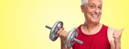 Senior man with dumbbell. Royalty Free Stock Photography