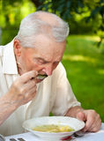 Senior man eating Royalty Free Stock Images
