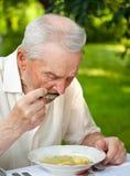 Senior man eating Royalty Free Stock Images