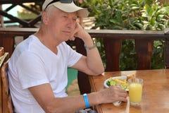 Senior man eating brekfast Royalty Free Stock Photography