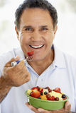 Senior Man Eating Fresh Fruit Salad Royalty Free Stock Image
