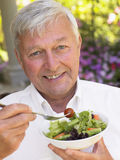 Senior Man Eating Fresh Salad Royalty Free Stock Images