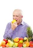 Senior man eating a green apple Stock Image