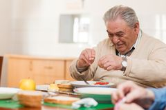Senior man eating Royalty Free Stock Photography