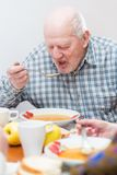 Senior man eating Royalty Free Stock Photo