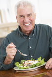 Senior Man Eating A Healthy Meal Stock Photography