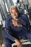 Senior Man Eating Healthy Snack. Happy senior man eating healthy snack at gym Royalty Free Stock Photo