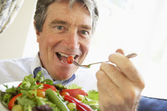 Senior Man Eating Salad stock photo