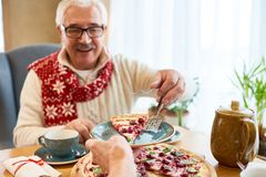 Senior Man Eating Sweet Pie at Christmas Dinner stock photos