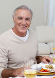 Senior man eating turkey in Christmas dinner Stock Photography