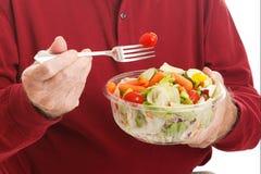 Senior Man Eats Salad - Closeup Stock Photo