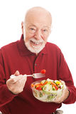 Senior Man Eats Salad Royalty Free Stock Photos