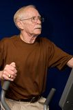 Senior Man On Elliptical Machine Royalty Free Stock Photography