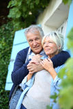 Senior man embracing his wife in the garden Stock Image