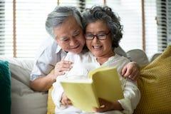 Senior Man embracing his wife stock image