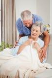 Senior man embracing woman at home Royalty Free Stock Photo