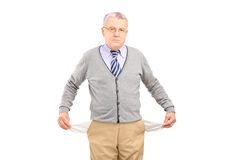 Senior man with empty pockets Royalty Free Stock Photo