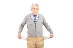 Senior man with empty pockets royalty free stock photo
