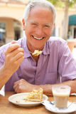 Senior Man Enjoying Coffee And Cake Royalty Free Stock Images