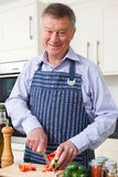 Senior Man Enjoying Cooking In Kitchen Stock Photo