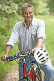 Senior Man Enjoying Cycle Ride In The Countryside Stock Images