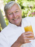 Senior man enjoying glass of juice Royalty Free Stock Image